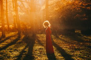 tale. fantastic redhead girl in a mysterious forest